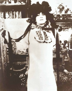 Model in a White Robe with a Hat with Ribbons